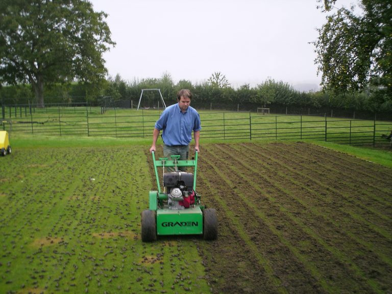 Breaking up soil cores after lawn aeration | Lawn Aeration